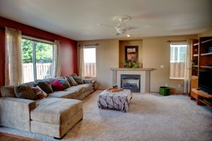 Spacious family room with gas fireplace.